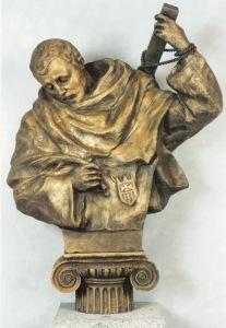 San Serapio, redentor y mártir, crucificado en forma de aspa. Protector de los que sufren por su fe. Obra en bronce semidorado de Lev Kerbe